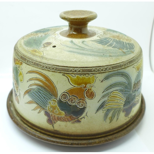 633 - A Doulton Lambeth jardiniere, two relief moulded jugs and a saltglaze cheese dish and cover, decorat...