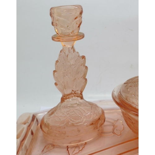 640 - A peach glass dressing table set, tray chipped...