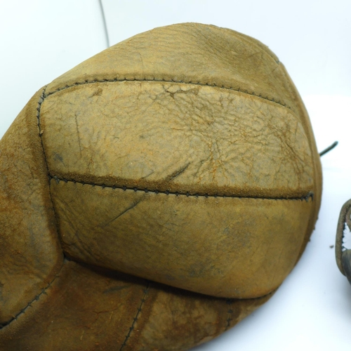 641 - A mid-20th Century leather football and a boxing speed bag...