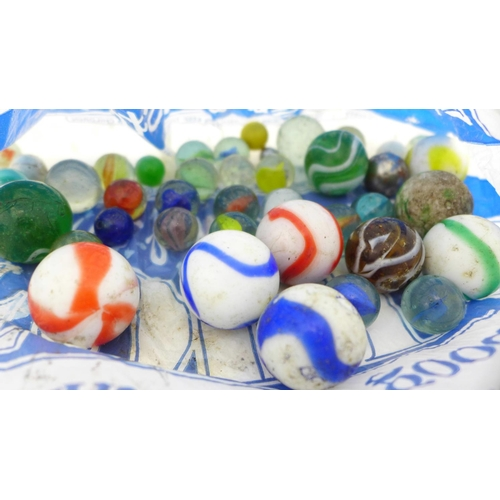 643 - Eight Wade Hatbox Disney Lady & The Tramp figures, Victorian and later glass marbles, two paperweigh...