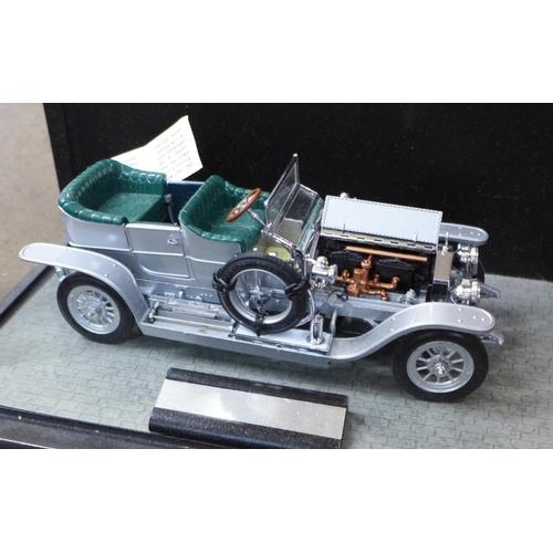 650 - A vintage Teddy bear, a/f, a boomerang and three model vehicles, Franklin Mint 1907 Rolls Royce, Mai...