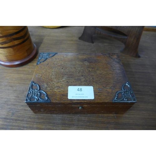 48 - An Arts and Crafts beech table top easel, 41cms h, with circular Pre-Raphaelite style print, an oak ...