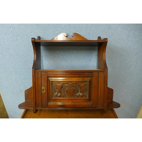 49 - An Edward VII carved walnut wall hanging cabinet, 59cms h x 70cms w...