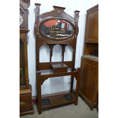 55 - An Arts and Crafts walnut hallstand, 193cms h, 83cms w, 31cms d...