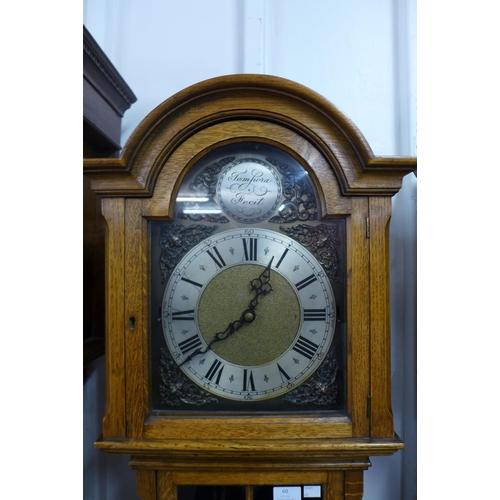 60 - An oak triple weight longcase clock, 192cms h, a/f...
