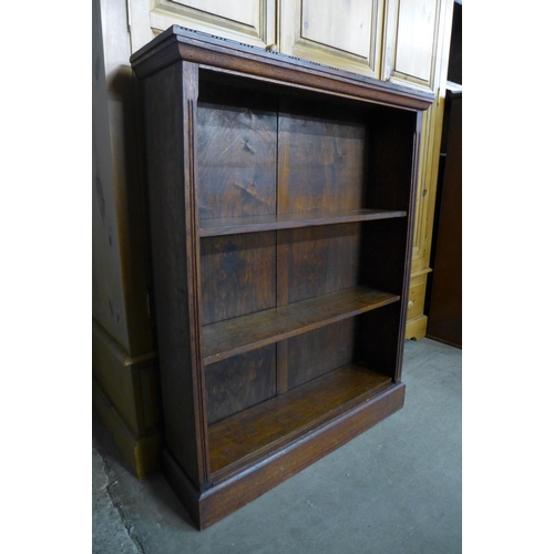 62 - An early 20th Century oak open bookcase, 107cms h, 84cms w, 23cms d...