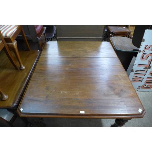 64 - A Victorian mahogany dining table, 75cms h, 125cms w, 147cms l...