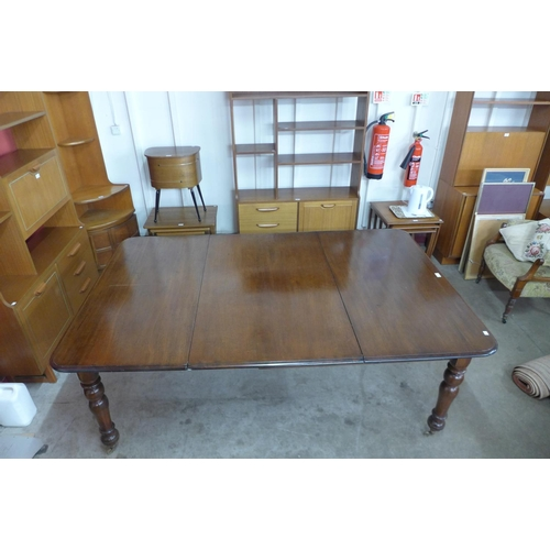 66 - A Victorian mahogany extending dining table, 73cms h, 121cms w, 191cms l...