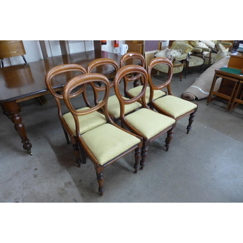 67 - A set of six Victorian mahogany balloon back dining chairs...