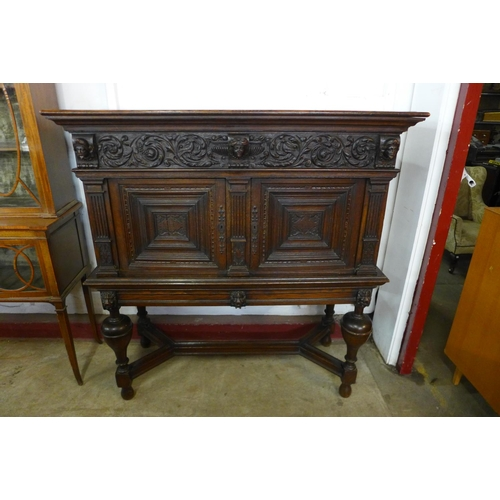 68 - A 19th Century French carved oak livery cupboard on stand, 143cms h, 136cms w, 58cms d...