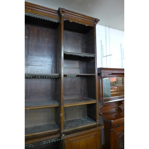 69 - An extremely large Victorian mahogany country house breakfront library bookcase, 286cms h, 358cms w,...
