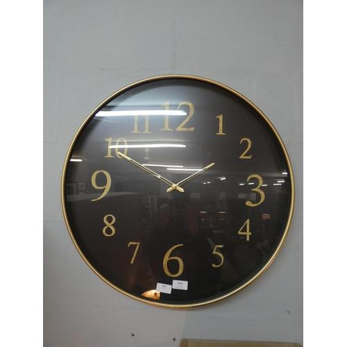 1423 - A black and gilt circular wall clock (2017824)   #...