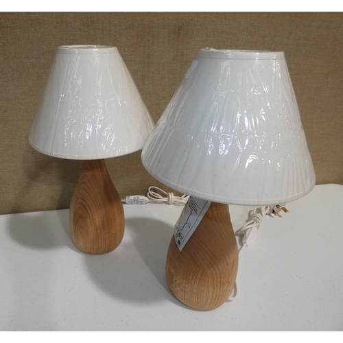 3017 - A pair of wooden based table lamps * this lot is subject to VAT...