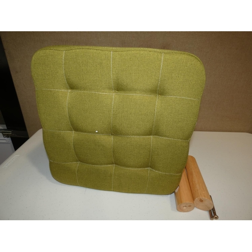 3019 - A green fabric footstool * this lot is subject to VAT...