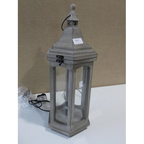 3025 - A wooden lantern table lamp * this lot is subject to VAT...
