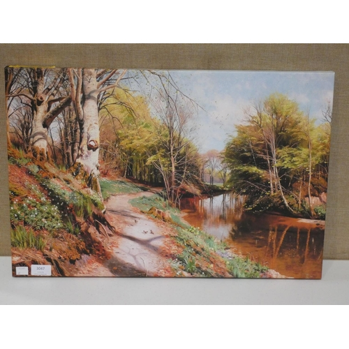 3047 - An Autumn River Path print on canvas (60 x 40cm) * this lot is subject to VAT...