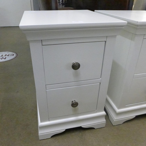 1383 - A white bedside chest * this lot is subject to VAT Marked....