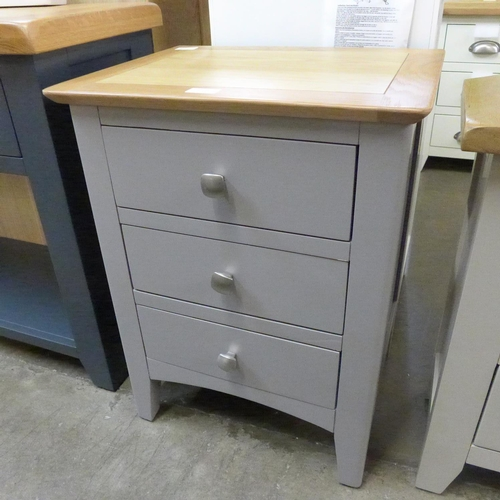 1397 - An oak and grey bedside chest * this lot is subject to VAT Marks to top left....