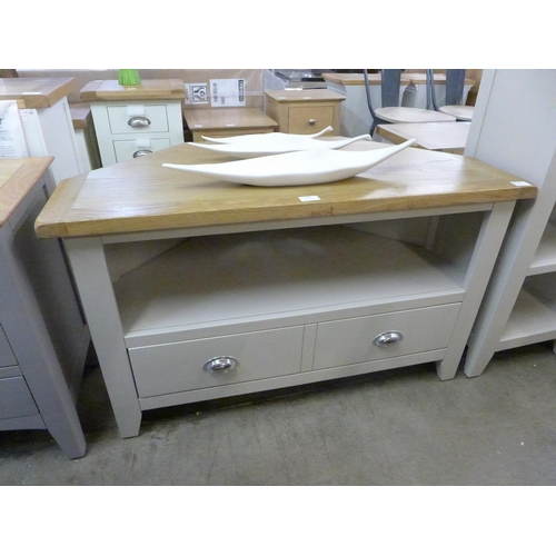 1398 - An oak and cream corner TV stand - marked top * this lot is subject to VAT...