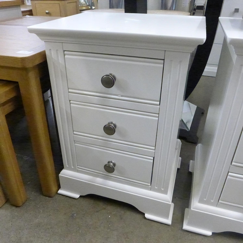 1403 - A white bedside chest * this lot is subject to VAT Damaged to top left back corner....