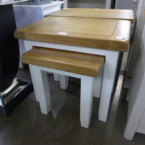 1413 - An oak and white nest of two tables * this lot is subject to VAT Marks to legs....