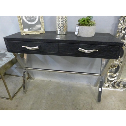 A snakeskin effect console table  *This lot is subject to VAT