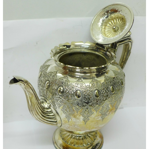 605 - A three piece silver plated and embossed tea service