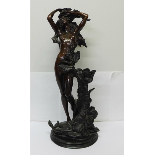 606 - A bronze statue of an Art Nouveau style nude with foliage, 44.5cm