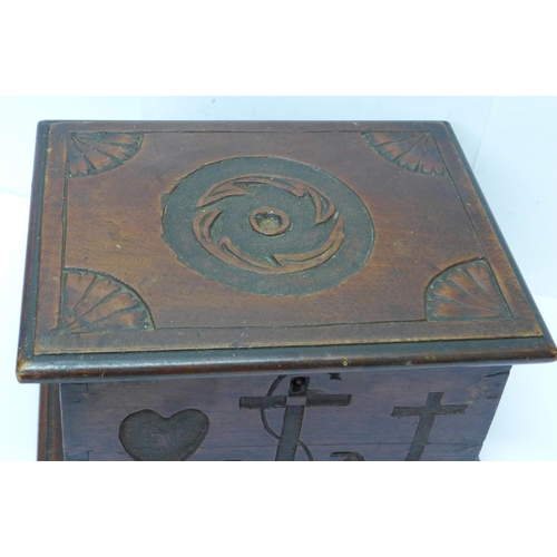 611 - A wooden box with Faith, Hope and Charity carvings...