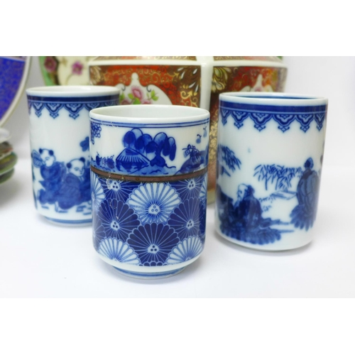 616 - Oriental pottery including three blue and white pots and dish, (two signed on the base) and a vase, ...