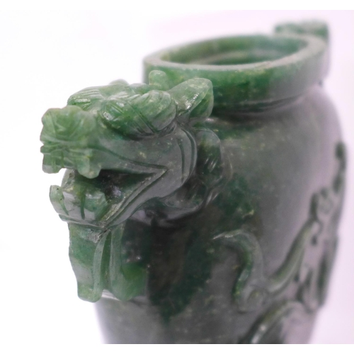 629 - A carved green stone urn with lid, small losses to the lid and one ring missing, 23cm