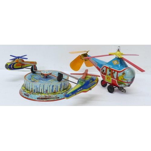 646 - A tin-plate clockwork helicopter toy, made in Western Germany, and one other tin-plate clockwork toy...