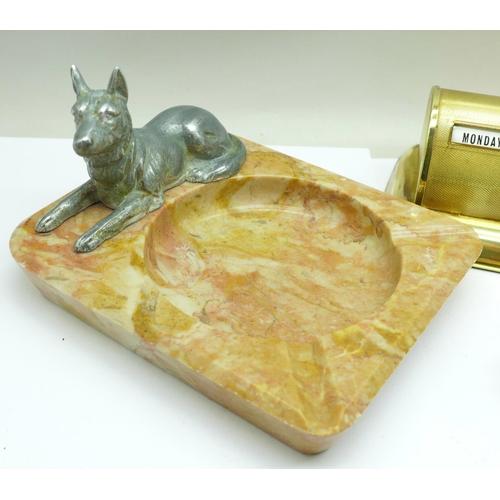 657 - A Stratton perpetual desk calendar, a pen holder on an onyx base and a hardstone ashtray mounted wit...