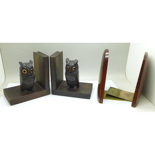 660 - Two pairs of bookends including carved owls with glass eyes, chip to ear