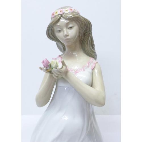 602 - A large Nao by Lladro porcelain figure, Springtime, designer Jose Roig, 42cm, some restoration to th...