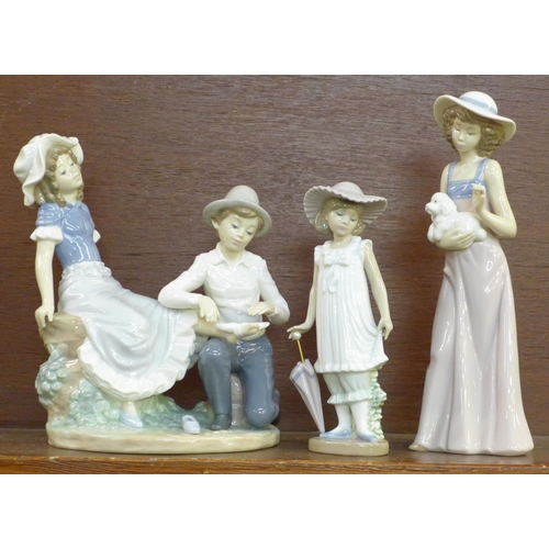 604 - Three Nao by Lladro porcelain figurines, Boy Bandaging Her Foot, Tender Moment, 22cm, model no. 0200...