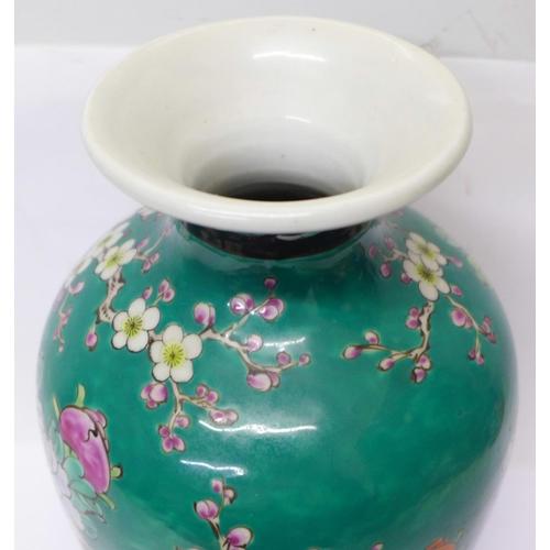 606 - An oriental vase, 24cm...