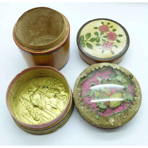 610 - Three treen items including a dice shaker and a circular box depicting a religious scene in the base...