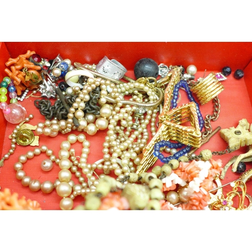612 - Two carved fans, costume necklaces including coral, etc., one fan a/f...