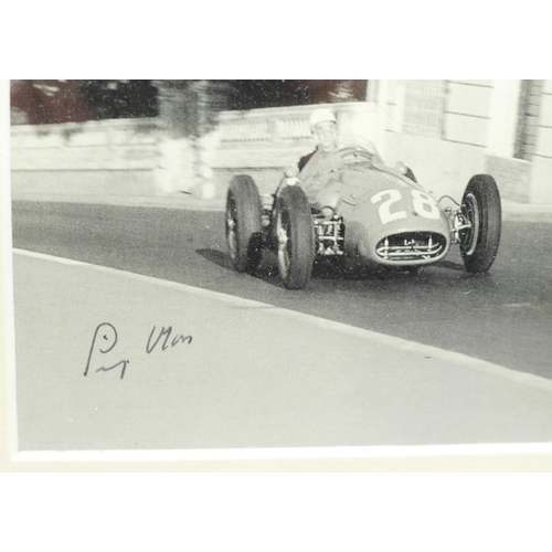 619 - A framed signed photograph of Stirling Moss at Monte Carlo...