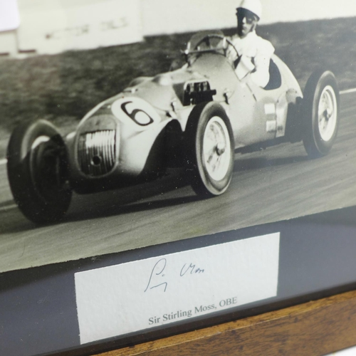 621 - A mounted picture and signature of Stirling Moss in 1951, framed...