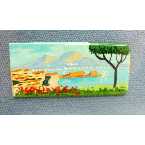 630 - Two small framed landscapes, one on ceramic, the other a print...