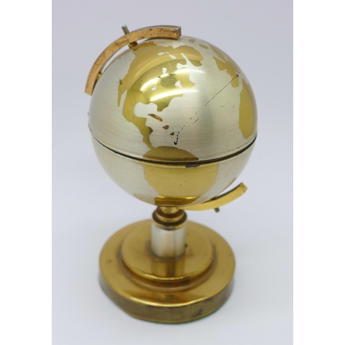 633a - A novelty table lighter in the form of a globe...