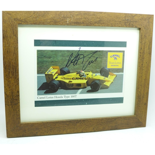 635 - A framed and signed picture of triple world champion Nelson Piquet...