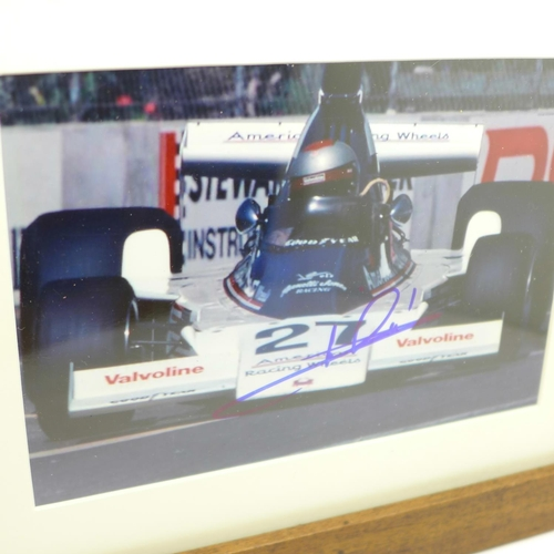 636 - A framed and signed photograph of 1978 world champion Mario Andretti...