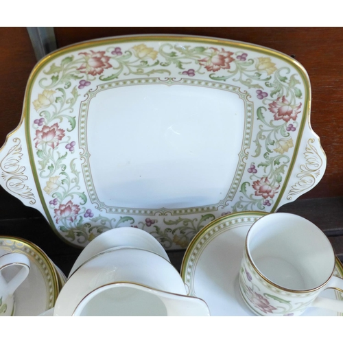 642 - A Royal Doulton Lichfield tea and coffee service, with teapot, cream and sugar, cake plate and eight...