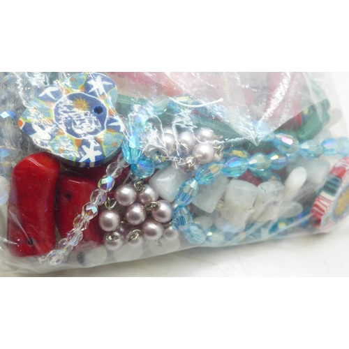 651 - A collection of jewellery components including findings, crystals, semi precious stones, beads, cord...
