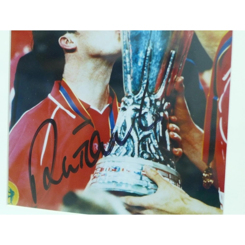 655 - A framed signed photograph of Robbie Fowler with UEFA Cup...