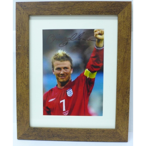 657 - A framed signed photograph of David Beckham...
