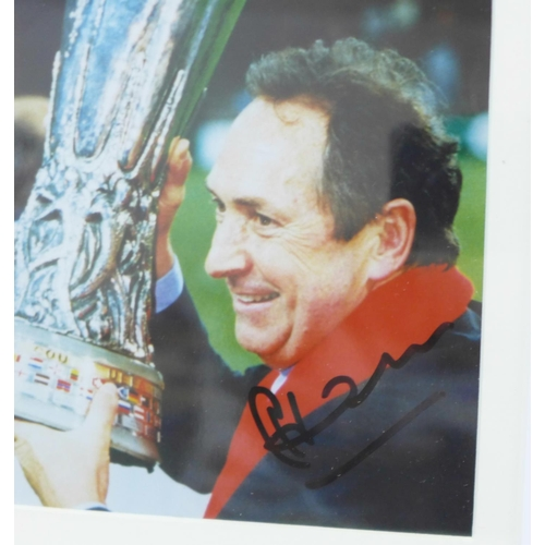658 - A framed signed photograph of Gerard Houllier with UEFA Cup...